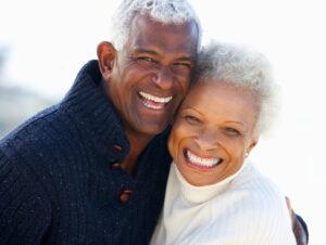 Happy hugging senior couple